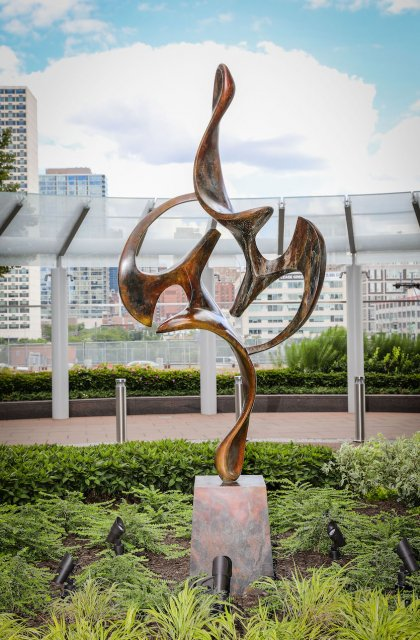 Acrobat by Dave Stevenson. 9' bronze at FMC TOWER/Cira Centre South, Philly